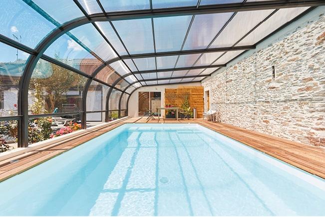 Bien choisir la forme de mon abri de piscine